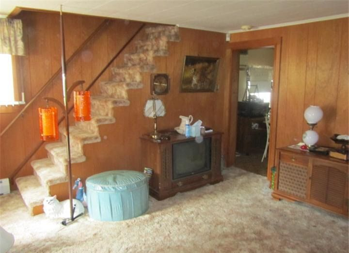 The Wood Paneling And That Pole Lamp Extends From Floor To Ceiling So