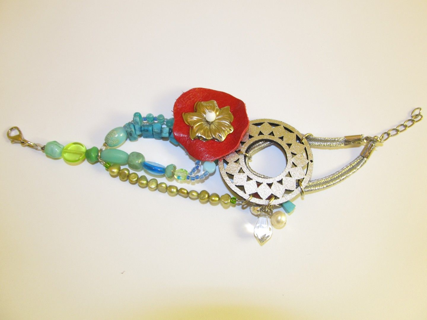 Handmade leather bracelet (1 pc)  Made with silver leather filigree, red leather part with metal silver tone flower, silver cord, gree freshwater pearls, turquoise chips and glass beads.
