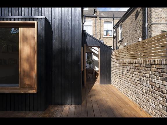 black vincent timber clad houses | Oliver Bayliss unveils black timber extension | News ...