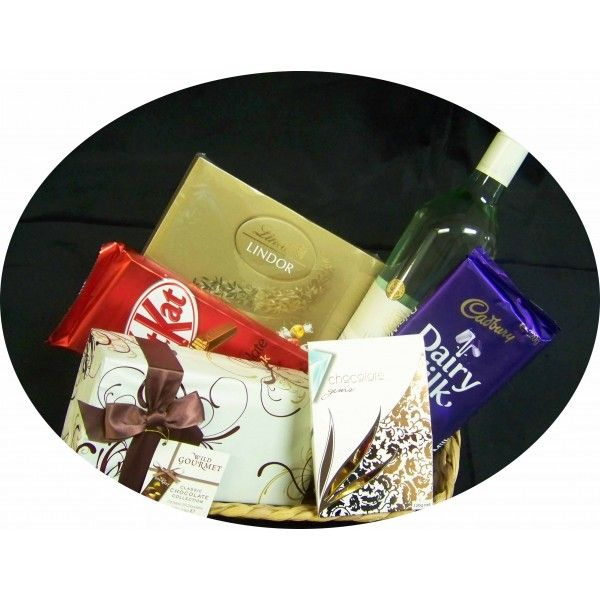 Gift basket includes - 	Brown Borthers Sauvignon Blanc 	Nestle Kit Kat block 	Wild Gourmet Chocolate Assortment 	Cadbury dairy Milk Block 	Lindt Lindor Chocolate Assortment 	Chocolate hearts Presented in a gift wrapped basket $94.95 #chocolate #wine #giftbasket www.astylishcelebration.com.au