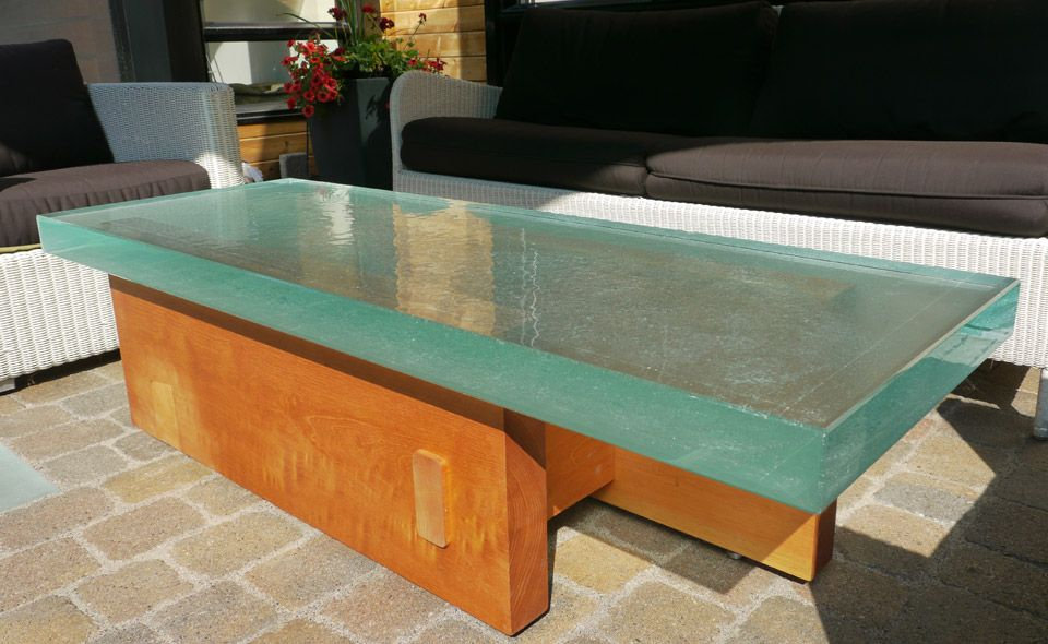 Great Looking Outside Coffee Table Made Of Very Thick Glass On A
