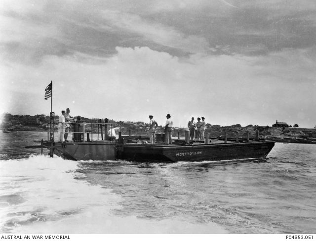 A US Army barge and sea mule of the Small Ships Section, United States Army…
