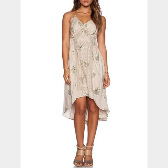 """Free People Fauna Dress Sweet printed and embroidered voile dress with a v-neck in front and an open strappy back with a center cutout. High low hem. 100% viscose. Approx. 34"""" shortest length and 44"""" longest length. Brand new and never worn. trades. Free People Dresses"""