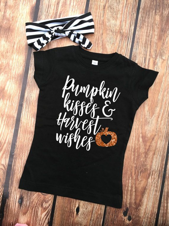 5cd23278b We absolutely adore this fall shirt with a unique saying: Pumpkin Kisses &…