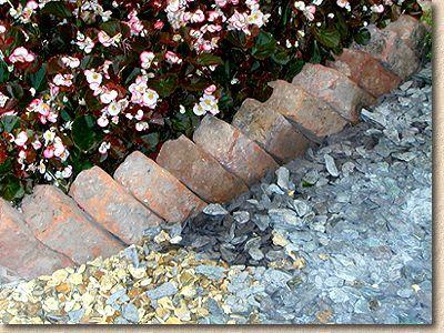 brick garden edging. sawtooth edging for the flower beds brick garden