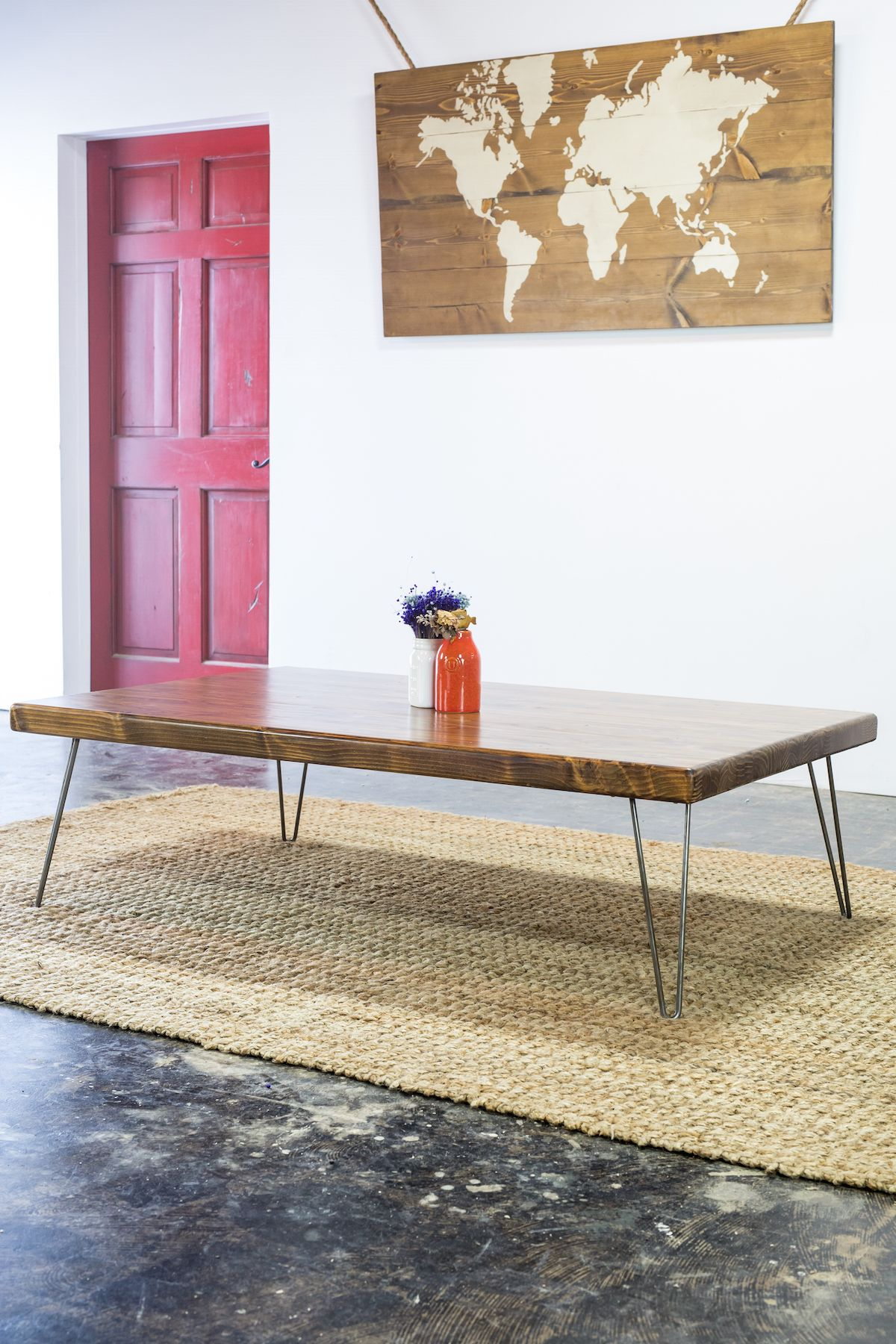 This robust and character filled coffee table is sure to impress any living room whimsical hairpin legs hold up a stout butcher block top