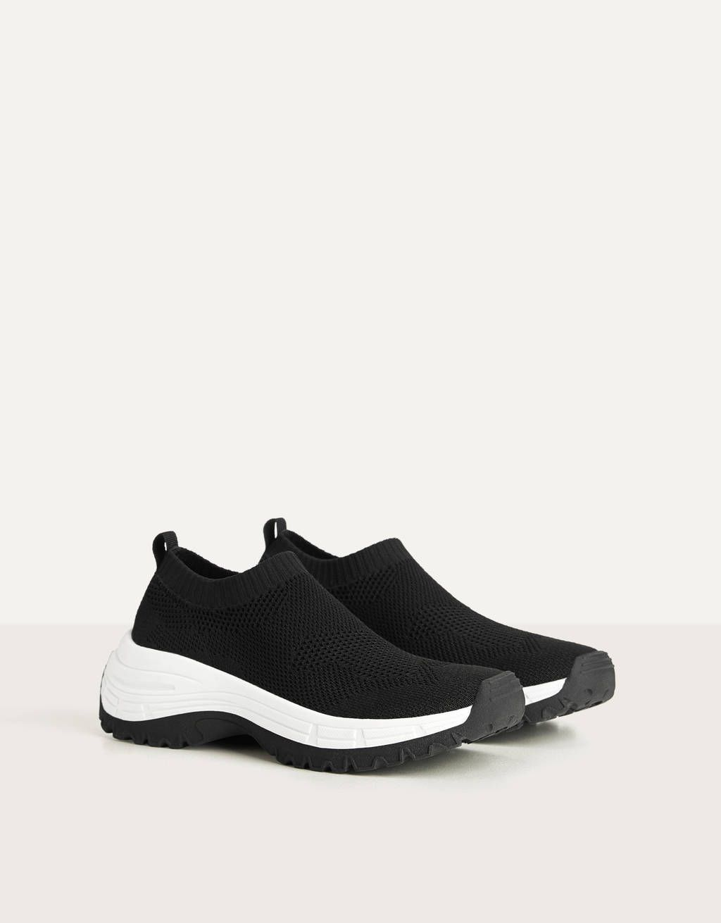 Mesh sock-style trainers. Discover this