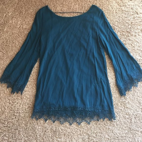 Bohemian dress with lace Deep turquoise with lace cuffs and bottom trim. Open back with single strand connection of top. From a boutique and worn once. Fun and flirty. Peppermint Dresses Mini