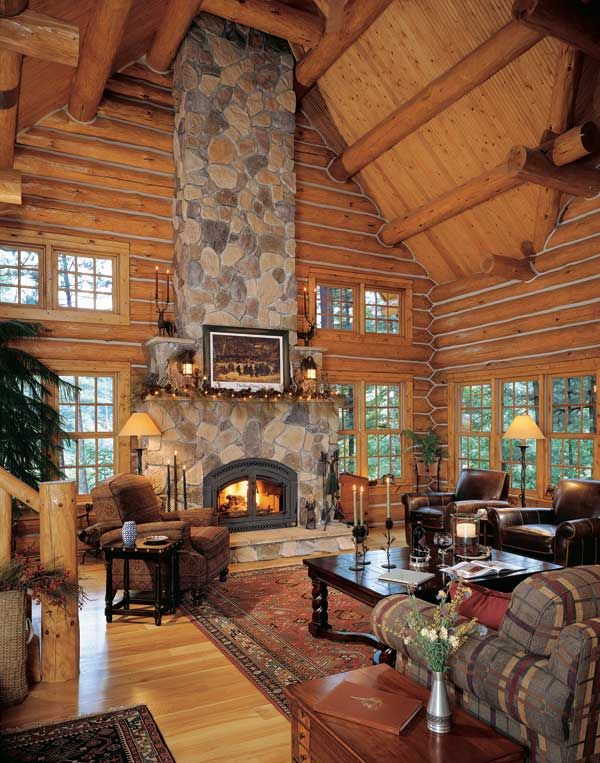 Hand peeled logs with chinking lots of windows and an open floor plan were the top criteria for this roomy home but don jeff wanted that sense log also stunning cabin homes fireplace design ideas interior rh pinterest