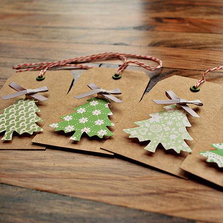 Christmas gift tags, die cut trees and a ribbon bow. Bakers twine for thread.