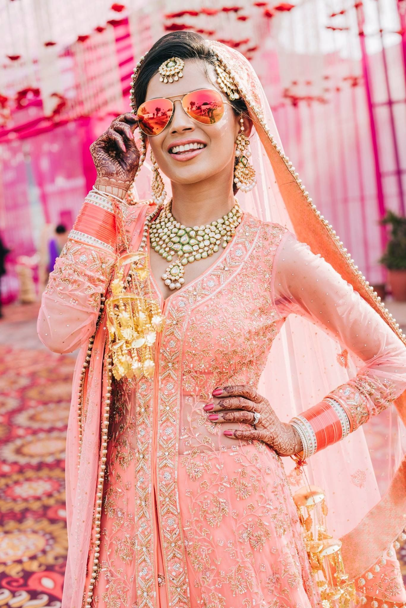 bride #punjabi #amritsar #coral #orange #lehnga #vogue #india ...