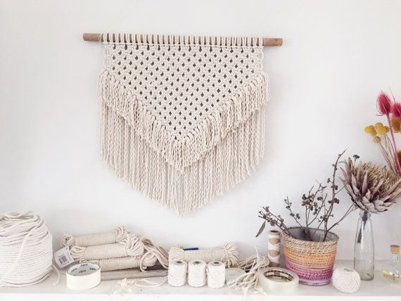One of a kind fringed style macrame wall hanging. Made from 100% Cotton un-dyed string and mounted onto wooden dowel. Dimensions are approx. 54cm long by 58cm wide (end to end dowel) Please contact me for any further info :)