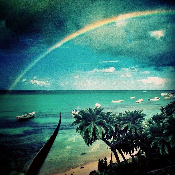 Beautiful rainbow dipping in the ocean, Mauritius
