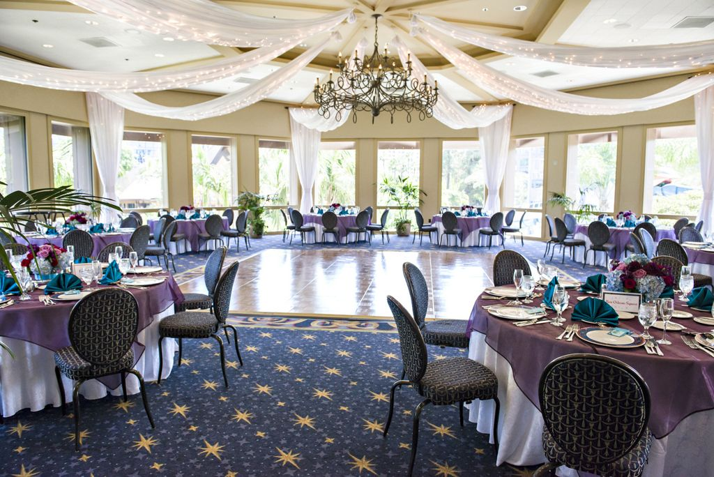 Sleeping Beauty Pavilion at the Disneyland Hotel - white draping with twinkle lights, purple organza table overlays, turquoise satin napkins
