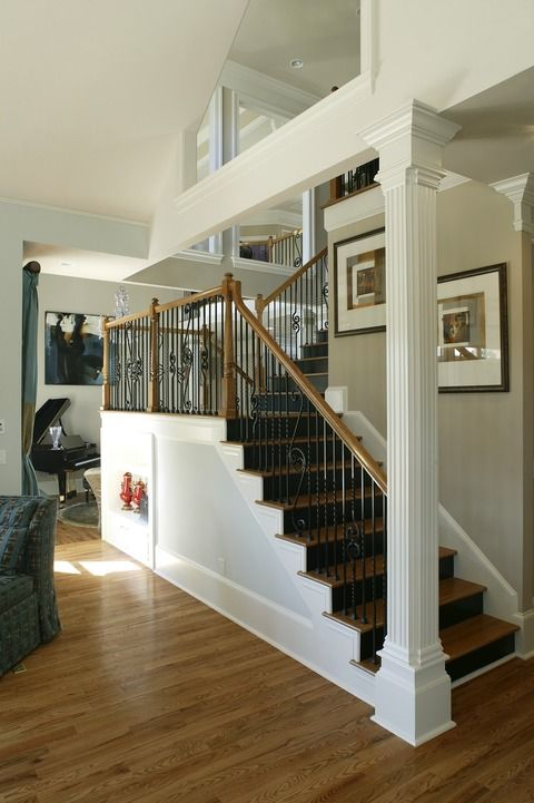Transitional Staircase With Iron And Wood Stair Railing