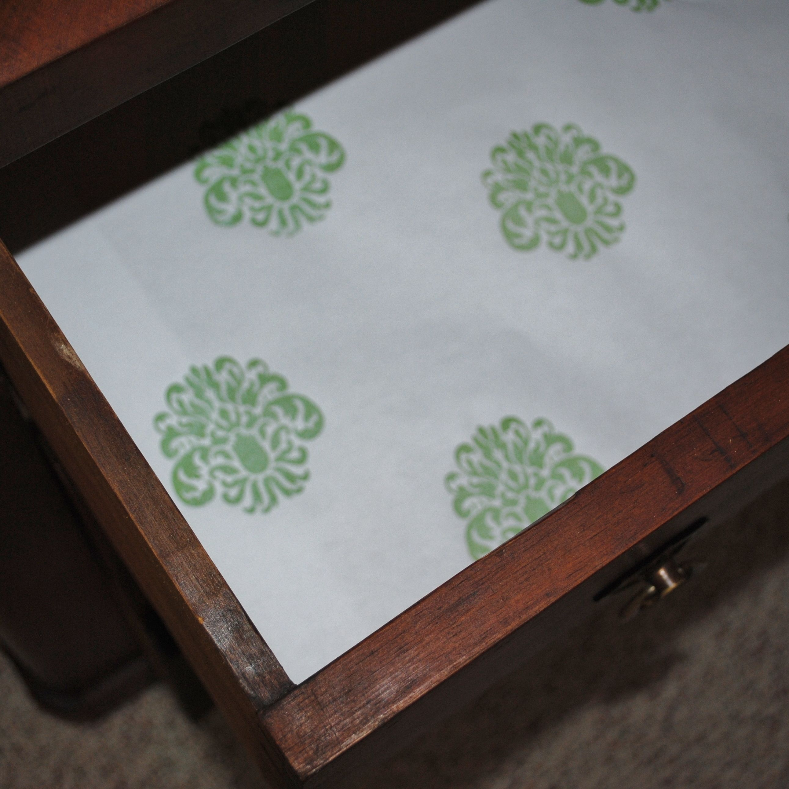 a drawers covering view with larger drawer paper furniture contact