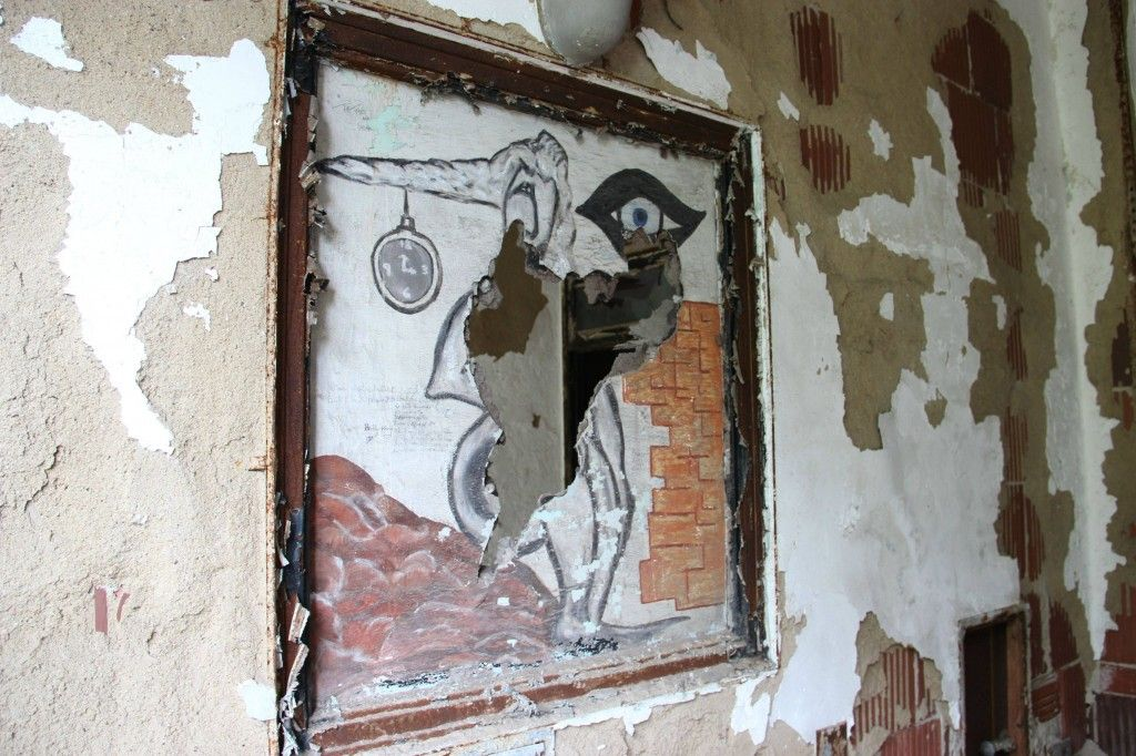 Forgotten art on the wall of a dying building, located on an abandoned island in New York City's harbor