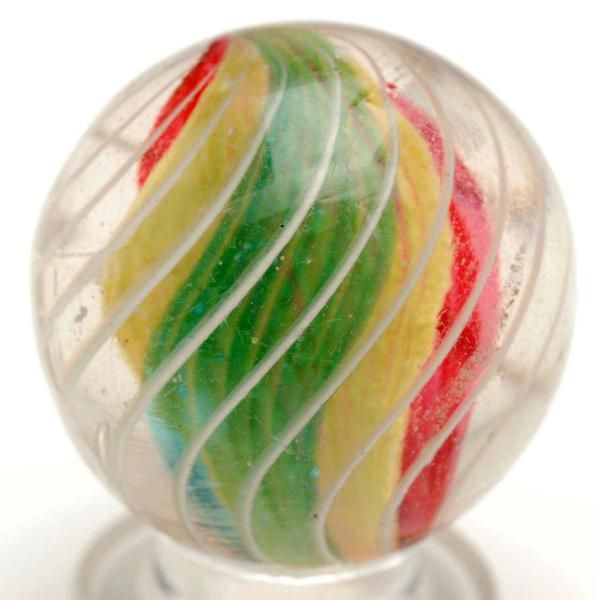 """Razor Ribbon Marble with Latticino Lines Price Realized $900 Razor ribbon white transparent red, yellow and turquoise with outer birdcage white latticino. Condition (9.5). Size 15/16"""" Dia."""