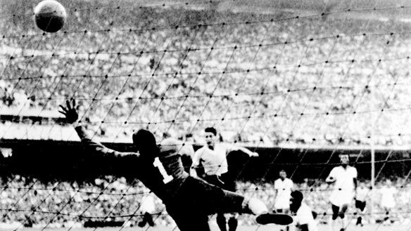 Juan Alberto Schiaffino scores the tying goal on Brazilian goalkeeper Moacyr Barbosa in the 1950 World Cup final in Rio. Uruguay went on to win 2-1.