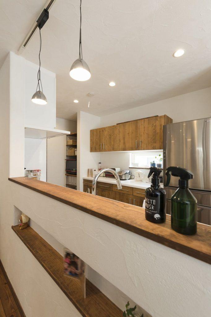 収納と動線がgood 自然素材の注文住宅 リビング キッチン 造作