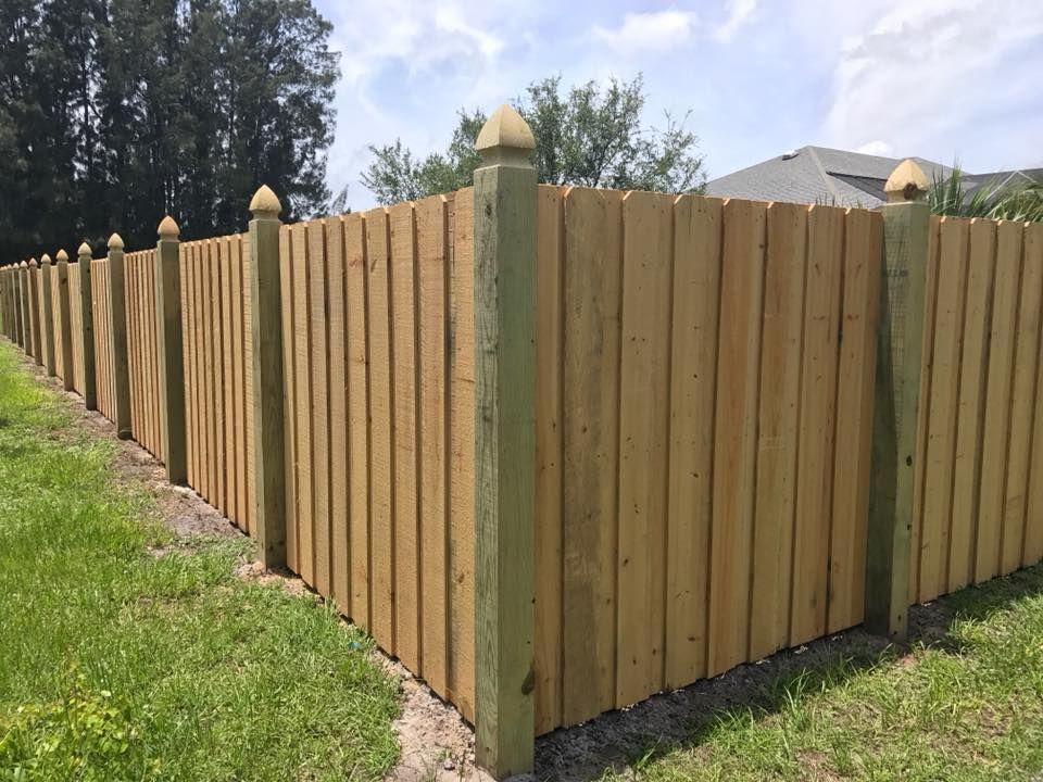 Board On Board Wood Fence With Gothic Fence Posts Mossy Oak Fence Orlando Melbourne Fl Wood Fence Design Fence Design Wood Fence