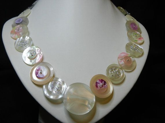 "Whisper of Pink is a unique, handmade button necklace, 20.5"" (52 cm) long, with white and pink buttons threaded onto wire."