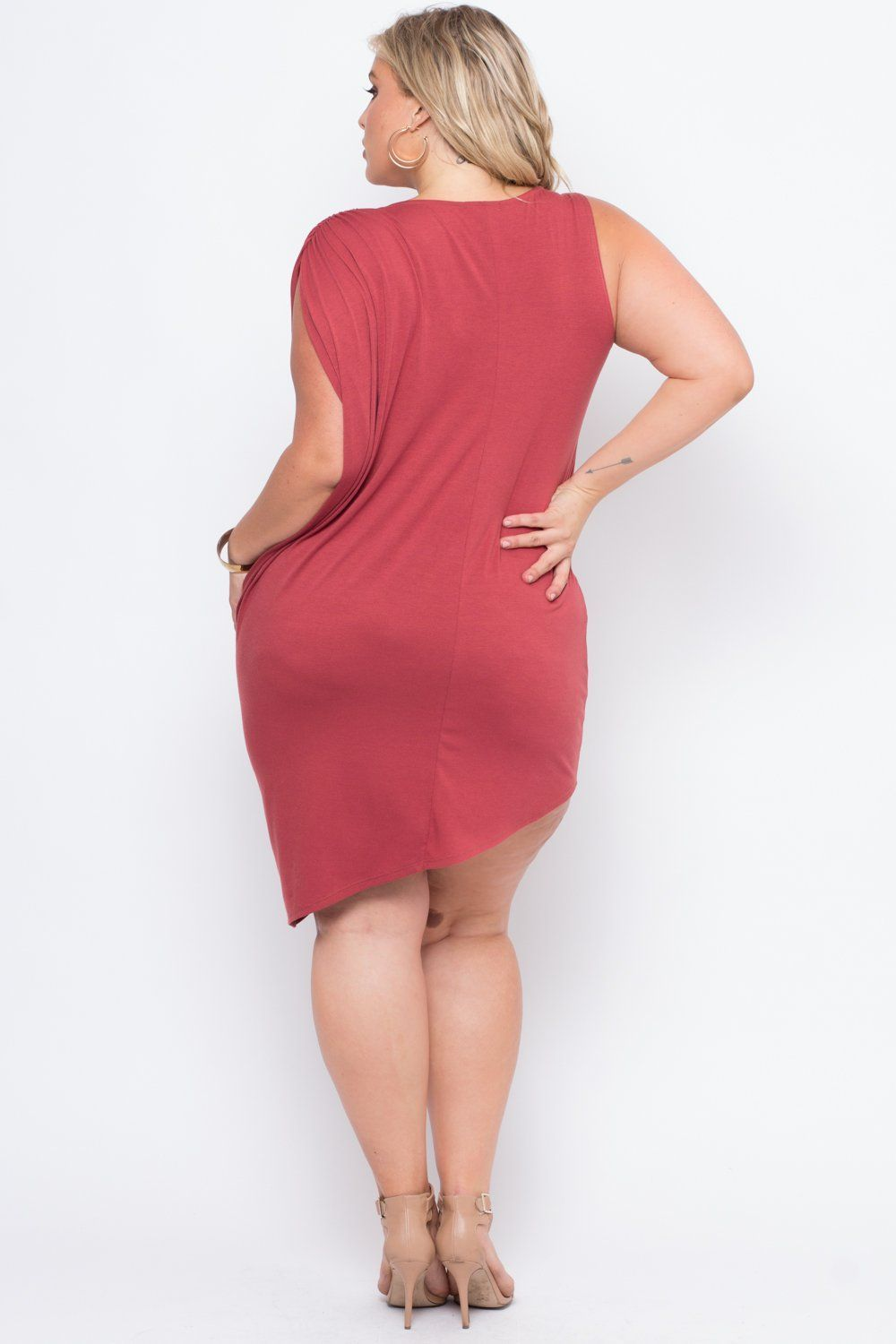 This plus size extra stretch jersey knit dress features a round