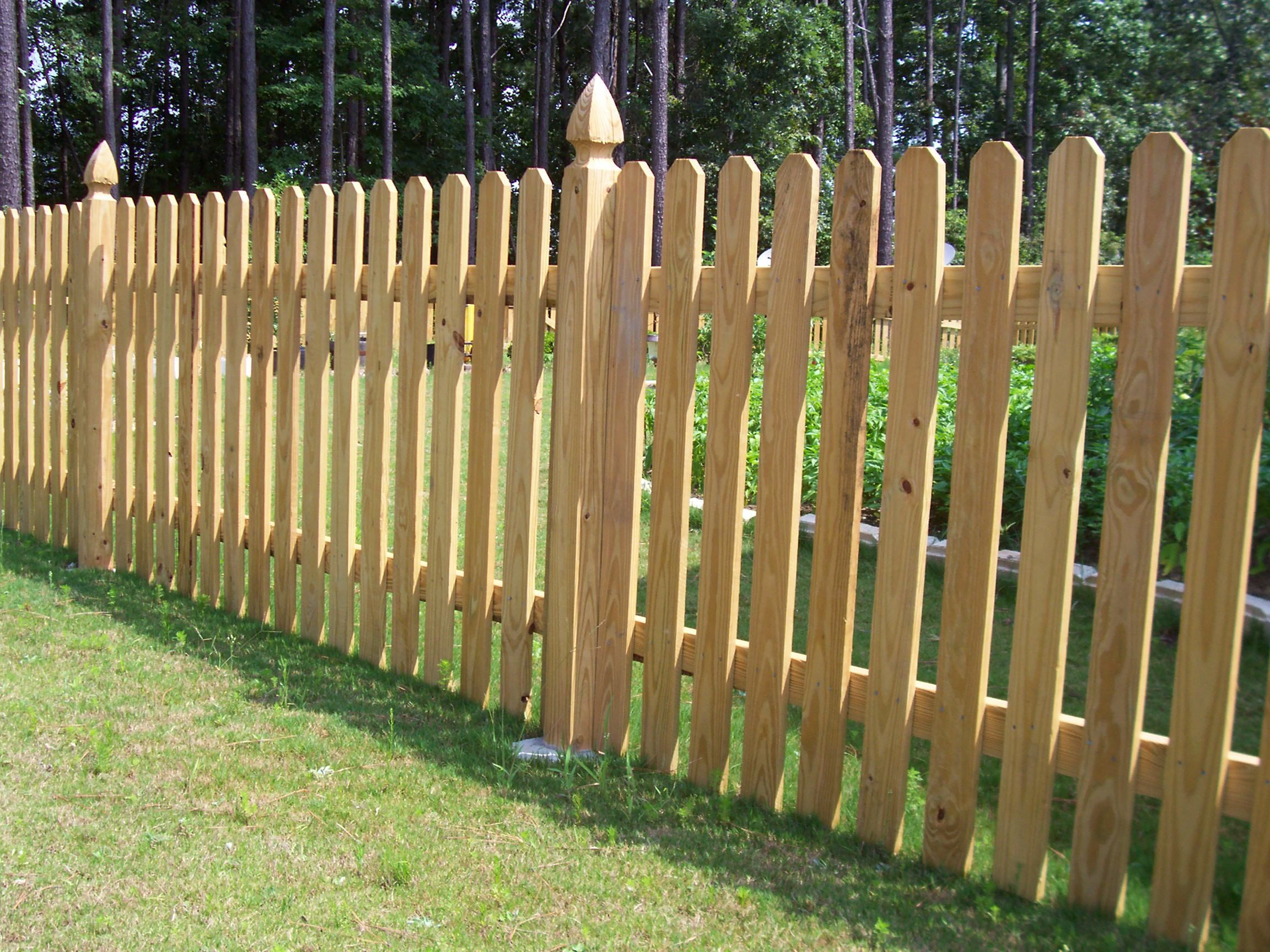 Custom wood picket fence by mossy oak fence wood fence designs wood dog ear picket fence designed by mossy oak fence baanklon Gallery