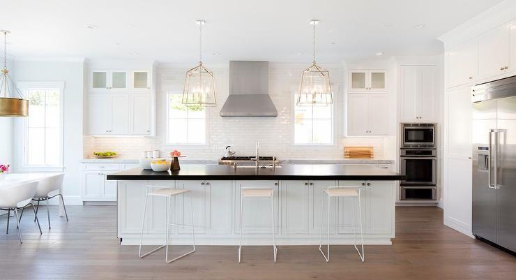 Best White Kitchen With Black Accents Boasts Sleek White Modern 400 x 300