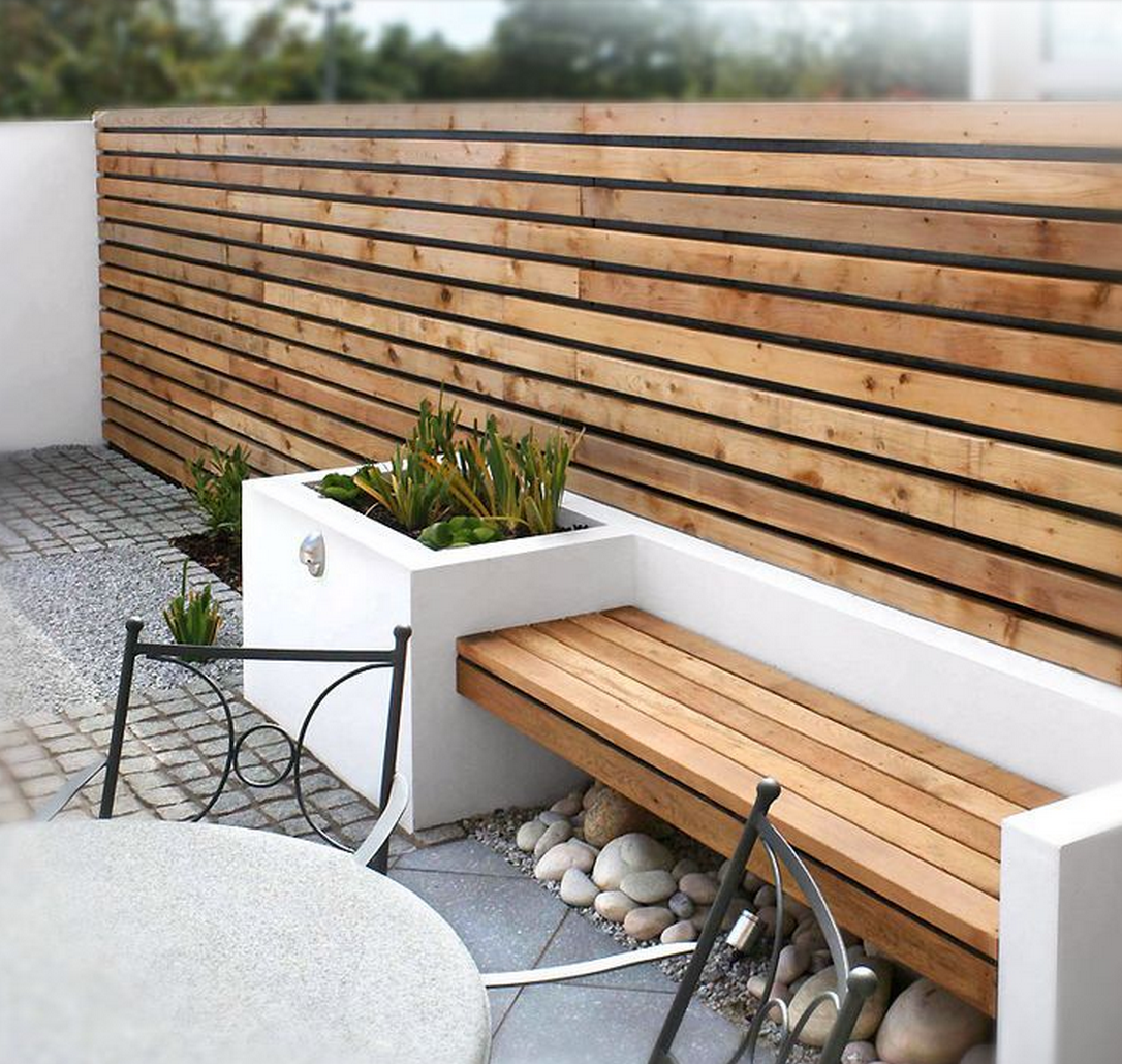Modern Outdoor Space With Wood Slat Wall Bench Outdoor Spaces Outside Exterior