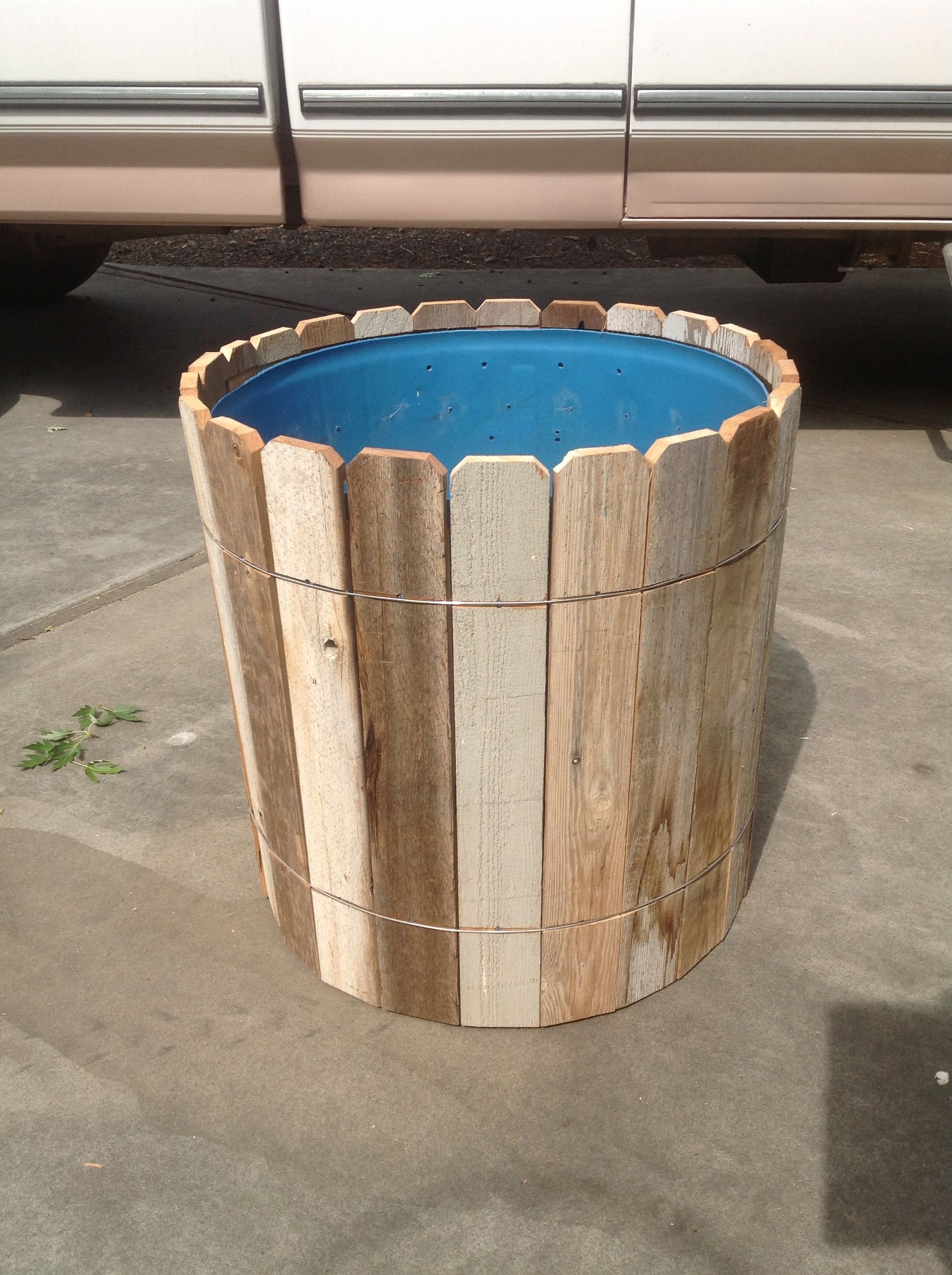 My husband made out of a large plastic barrel diy old for Wooden barrel planter ideas