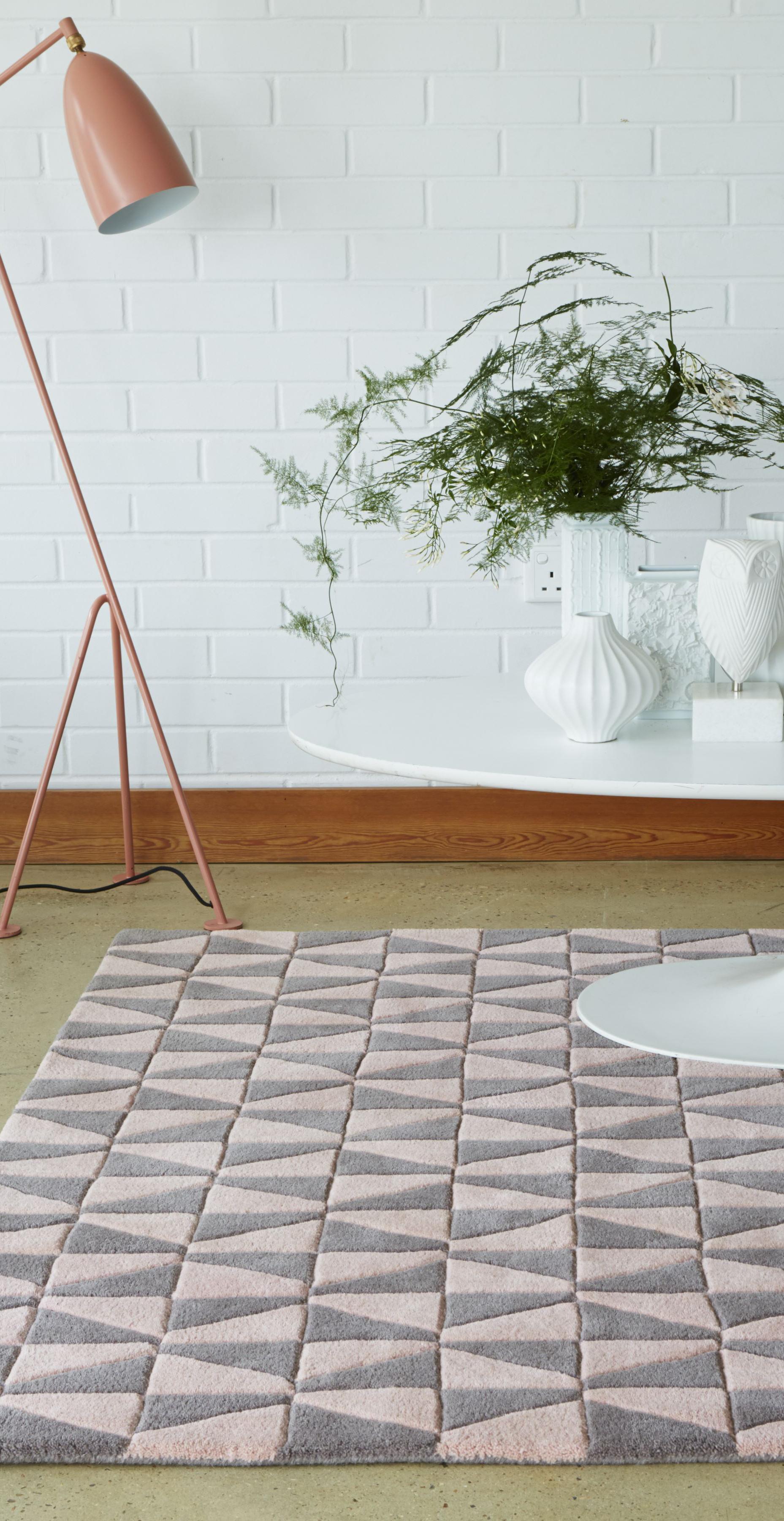 Pastel area rug with geometric design