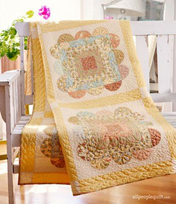 Create a fresh variation of the traditional Log Cabin block. Surrounding each block with simple appliqué pieces gives the blocks a softer, more feminine look.