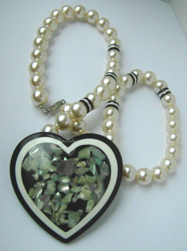 Big, honkin queen-size mother of pearl confetti lucite heart with a string of faux pearls