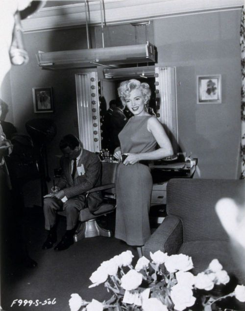 April 15, 1954:Marilyn Monroe is interviewed in front of a press conference in Hollywood to celebrate her return to 20th Century Fox. Photographed by John Florea.