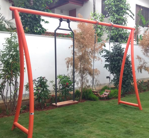 A Two-deck Swing Made For An Individual's Backyard