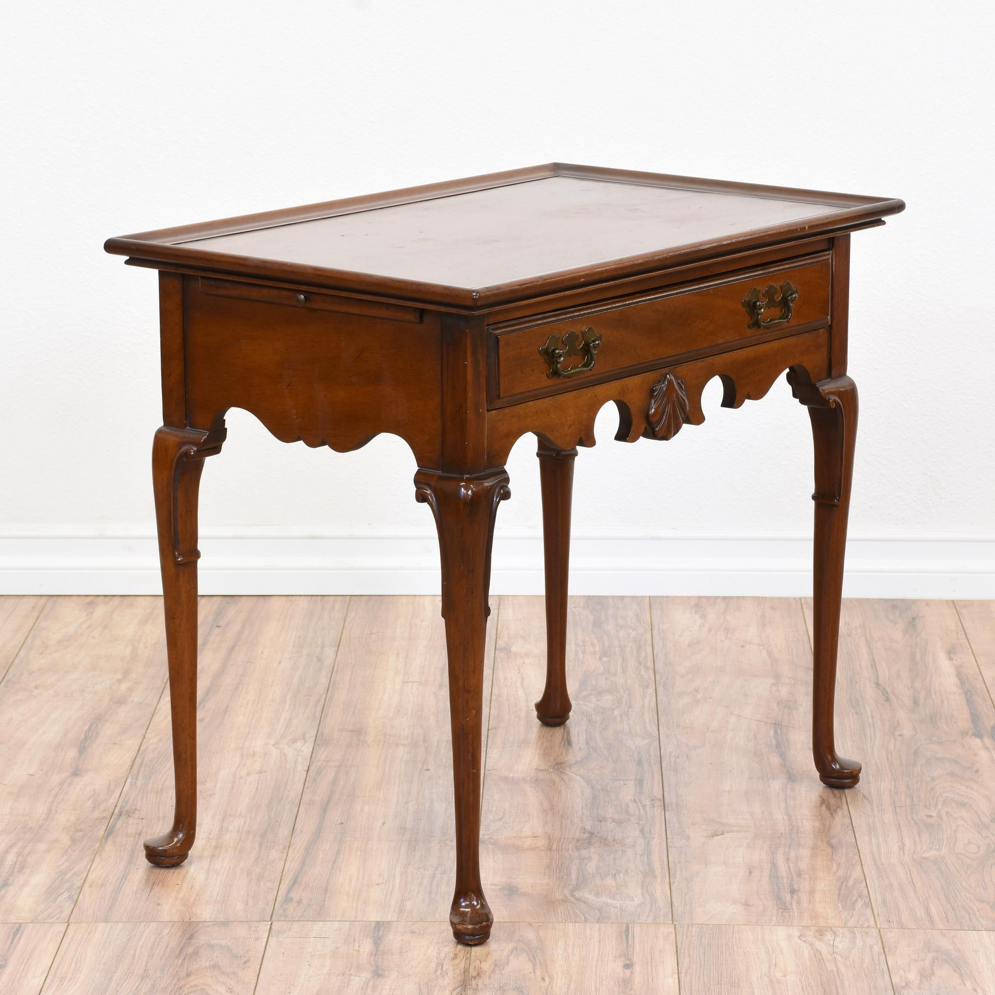 This queen anne style console table is featured in a solid wood this queen anne style console table is featured in a solid wood with a glossy light cherry finish and curved trim this sofa table is in great condition geotapseo Choice Image