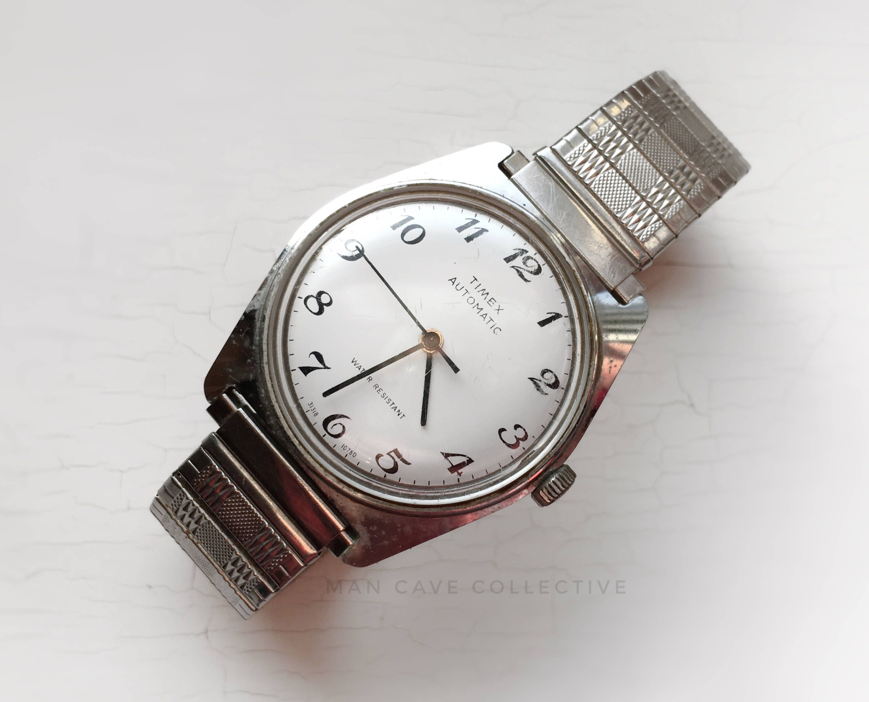 9da016521 Runs Automatic Timex Windup Water Resistant Watch Vintage Round Large  Silver Stretch Band Men's Women's Accessories