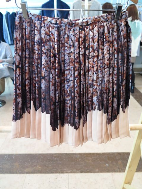 Knife pleats were a hit at the Paris Women's trade shows this weekend. Here's a dramatic, dripped floral print skirt from CacharelR...