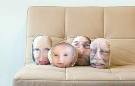 i don't know about faces on the pillows but photographs of favorite objets or something - there might be a worthy (playful) idea here.