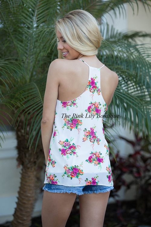 This tank is going to be just one of those things that will always be in the front of your closet - it is so easy to wear all spring and summer long! Featuring fuchsia, neon orange, lime green, and black, the floral print on this white tank couldn't be more beautiful! It also has a halter style, cutouts in back, and lightweight fabric that will stay cool!