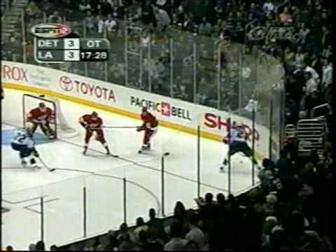 2001 Playoffs: LA Kings (Part 4 of 4) Game 4 - The Frenzy on Figueroa: The Kings scored 3 goals late in the 3rd to send the game into overtime. Eric Belanger completes the comeback. Here's the call by two guys not Bob and Jim.