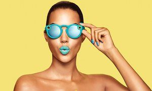 A model wears a pair of Snap Spectacles.