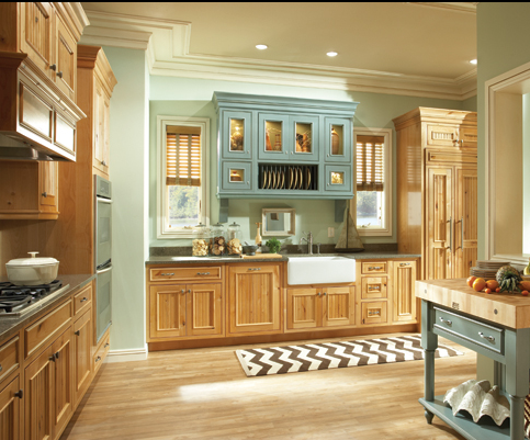 The colors in the expansive cabinetry match nicely with those of the butcher block in this Kitchens By Designs (Kettering, OH) kitchen, creating an appetizing environment. #kitchen #butcherblock #housetrends