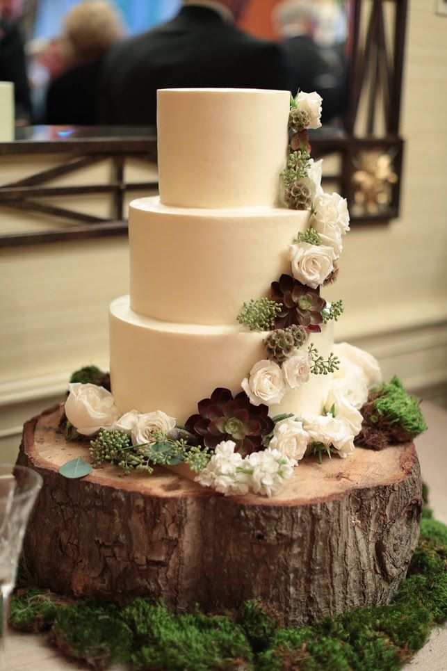 Gorgeous Rustic All White Cake With Sage And Flowers On A Tree Stump Moss