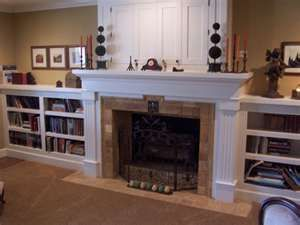 I Love The Short Bookcases Flanking The Fireplace And Guess Where The Tv Is Hidden Fireplace Surrounds Fireplace Bookshelves Fireplace Bookcase