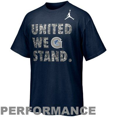 """Made of Nike's moisture-wicking Dri-FIT fabric, this super soft tee features camouflage """"United We Stand"""" lettering and a school logo printed on the front for a rousing shout out to Georgetown and the US Armed Forces!"""