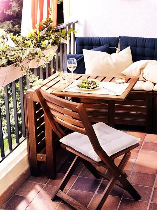 Ikea balcony socker pots wood table and chairs