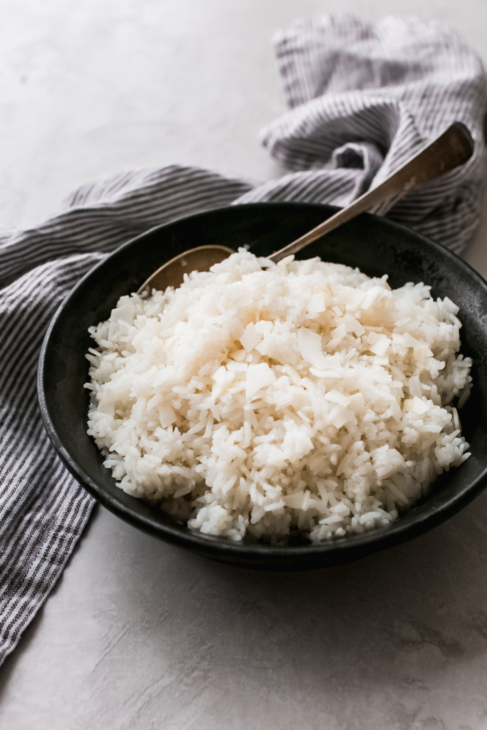 5 Ingredient Instant Pot Coconut Rice - Learn how to make coconut rice in the instant pot. A simple recipe that takes about 5 minutes to toss together and goes with so many different types of cuisines! #instantpot #instantpotrecipes #instantpotcoconutrice #coconutrice #jasminerice #jasminecoconutrice   Littlespicejar.com