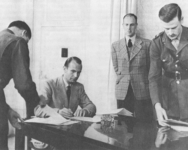 German representatives sign surrender document of 1 million German troops in Italy and Austria, Caserta, Italy, 29 April 1945 (US Army Center of Military History).